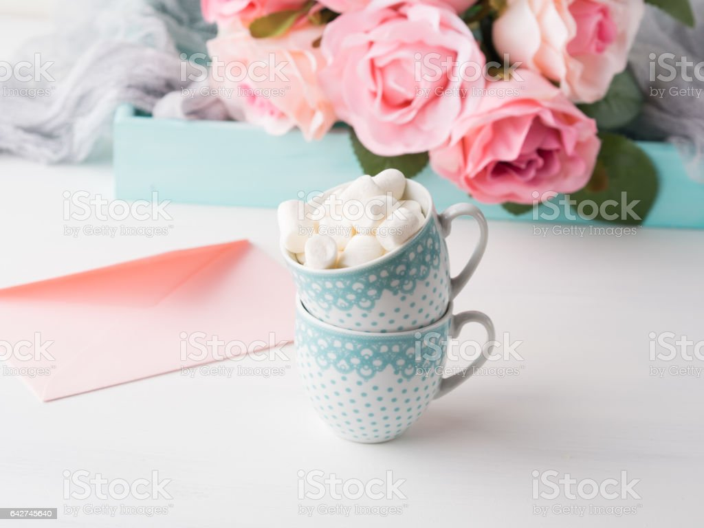 Two cups card Valentine's day envelope and roses stock photo