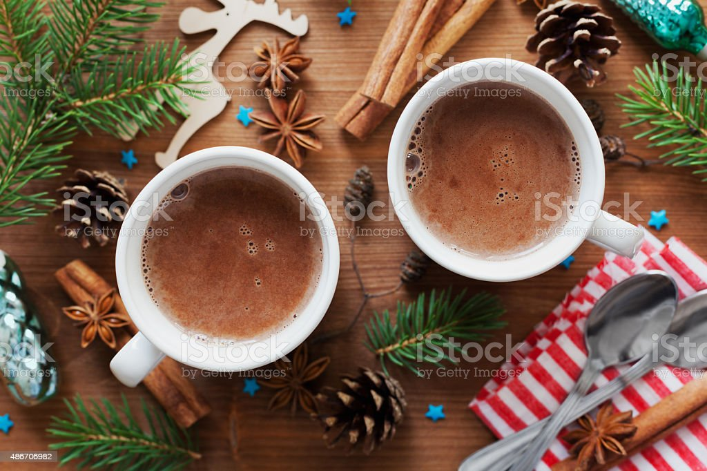 Two cups cocoa or hot chocolate on wooden christmas background stock photo