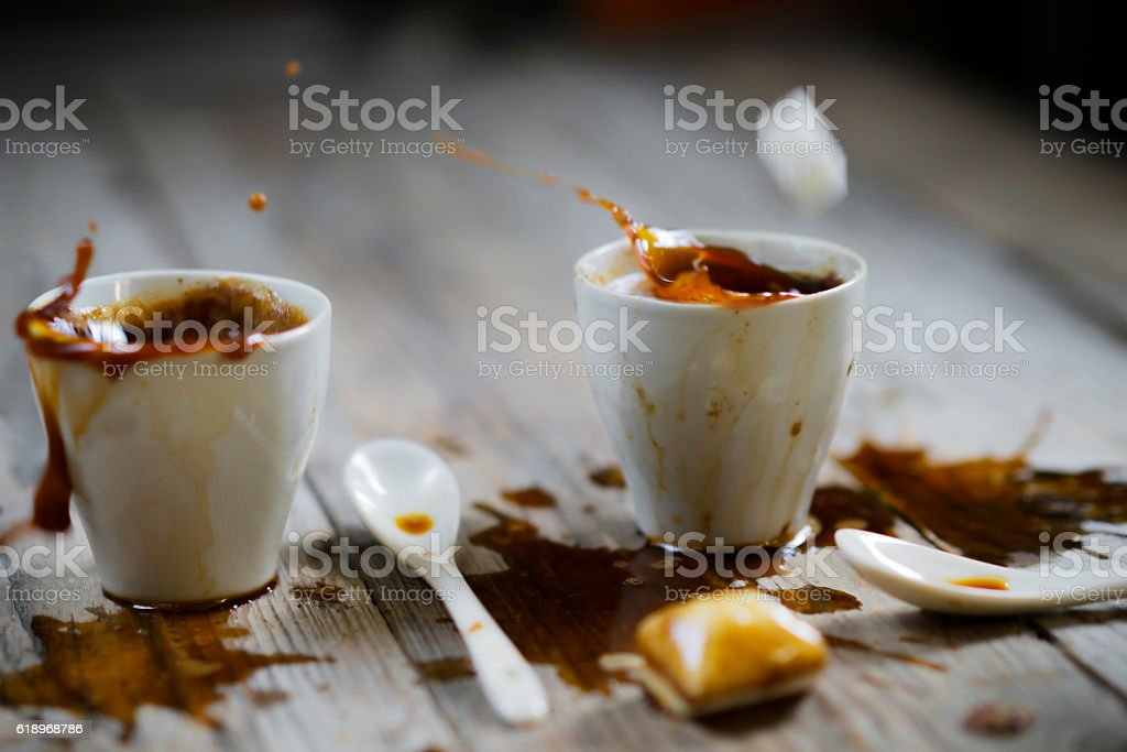 Two cups of coffee on beige doily on wood table stock photo