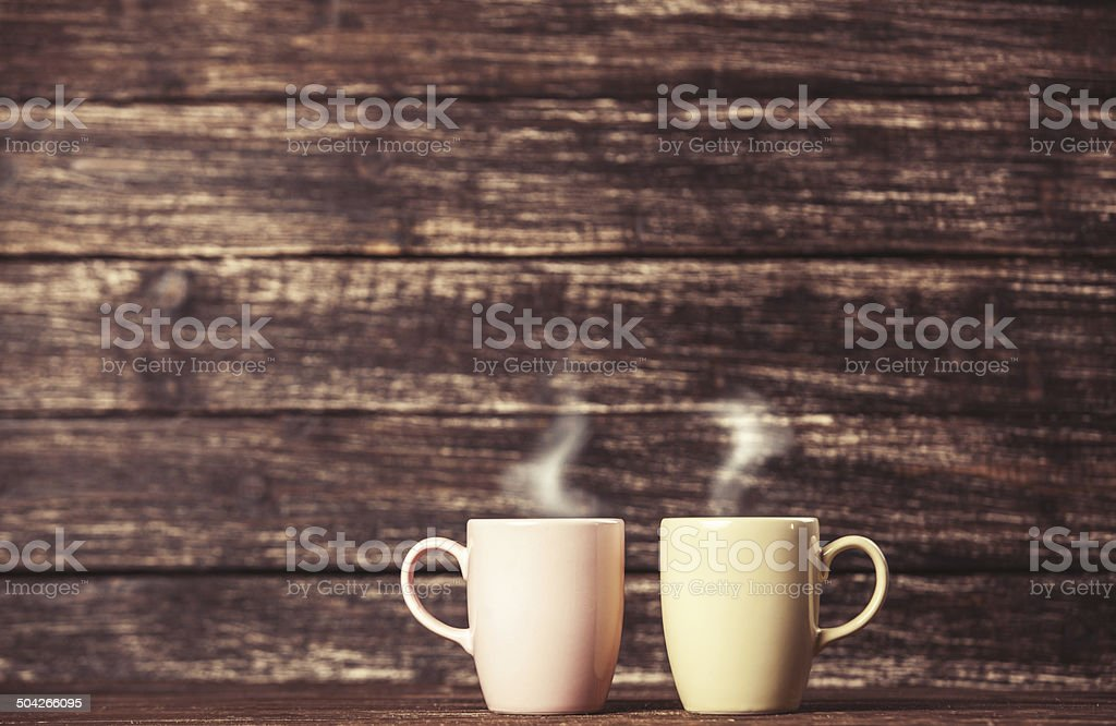 Two cups of coffee on wooden table. stock photo