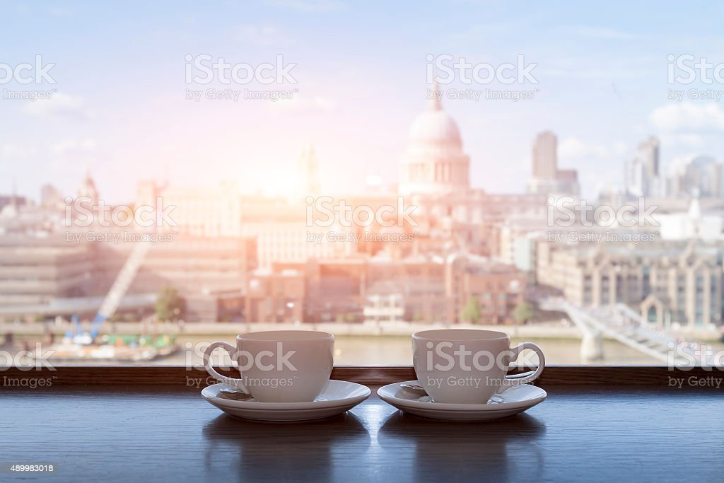 Two cups of coffee with panoramic view of a city stock photo