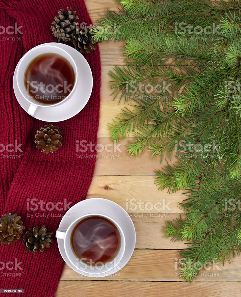 Two cups of drink, and Christmas tree branches. Christmas. Communication. stock photo