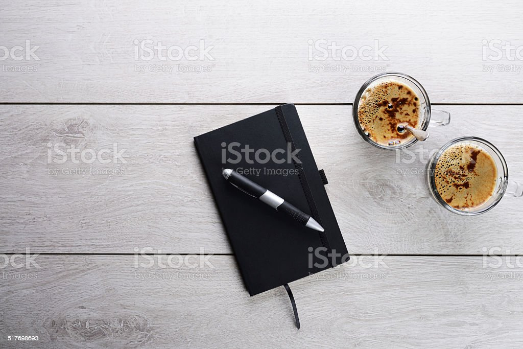 Two cups of espresso and address book stock photo