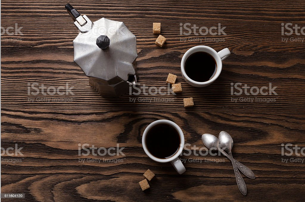 Two cups of espresso  and Italian  coffee maker. stock photo
