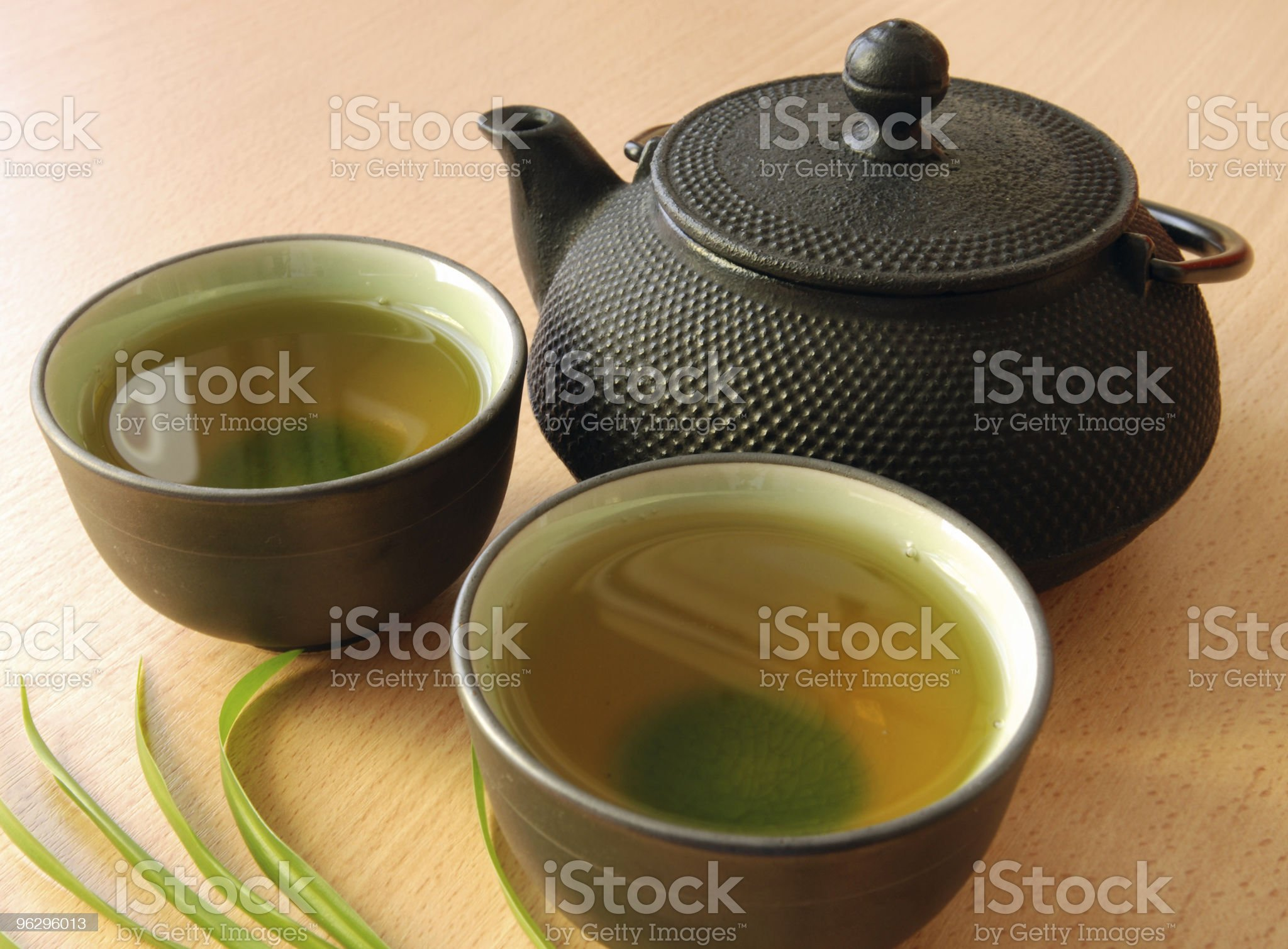 Two cups of green tea accompanied by a teapot royalty-free stock photo