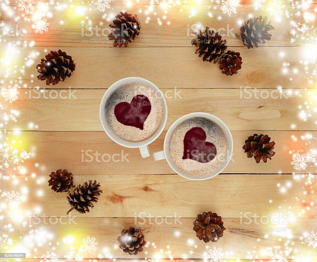 Two cups of hot drink and festive tinsel. Concept. Christmas. stock photo
