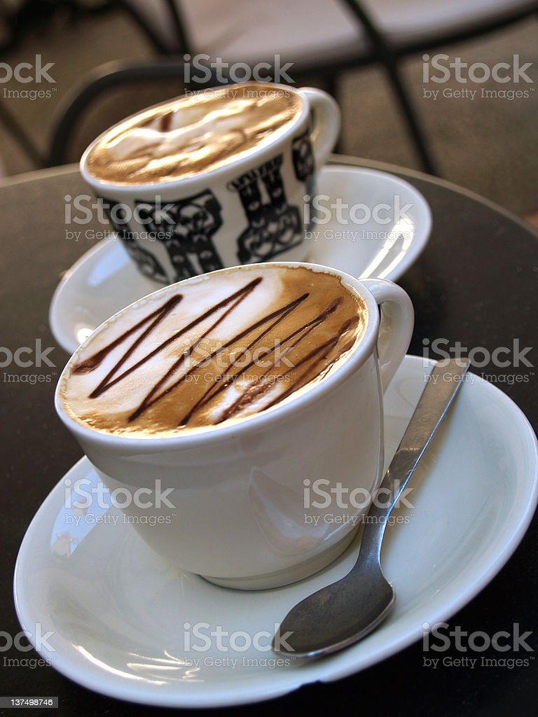Two cups of serve coffee royalty-free stock photo