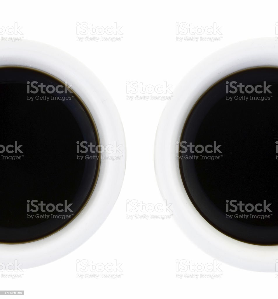 Two cups of strong, black coffee on white background royalty-free stock photo
