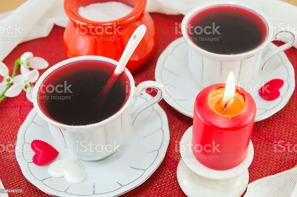 Two cups of tea and a burning candle royalty-free stock photo