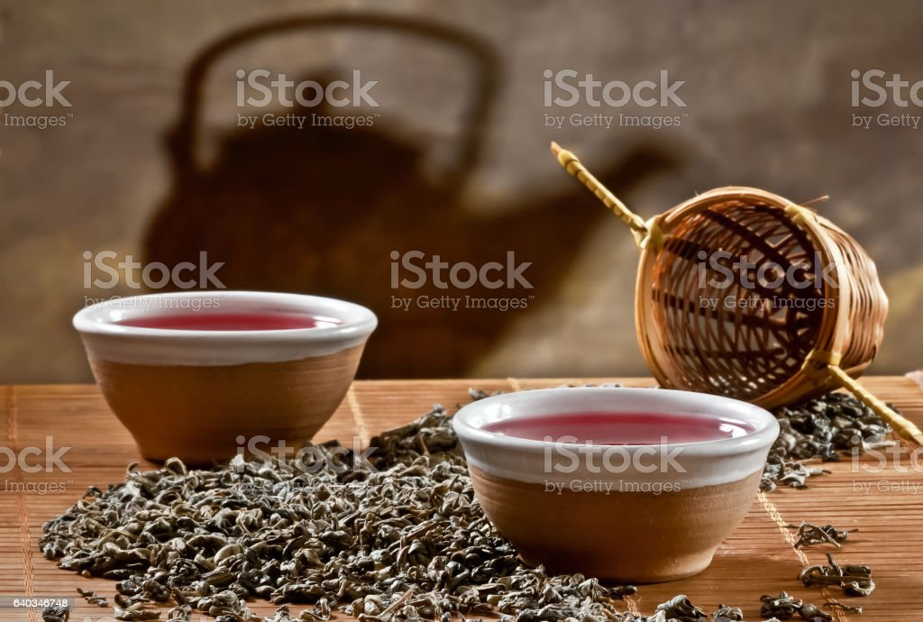 Two cups of tea with shaedow of kettle stock photo