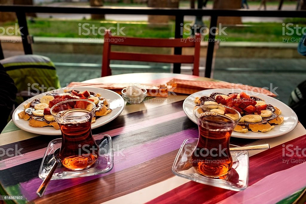 Two cups of Turkish tea with the dessert stock photo