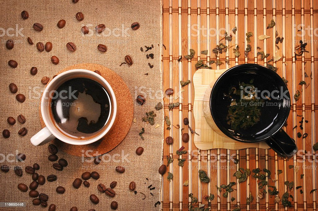 Two cups, one with tea and the other with coffee stock photo