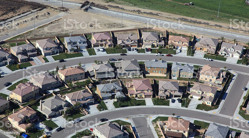 Two curved streets of houses in a new suburban development stock photo