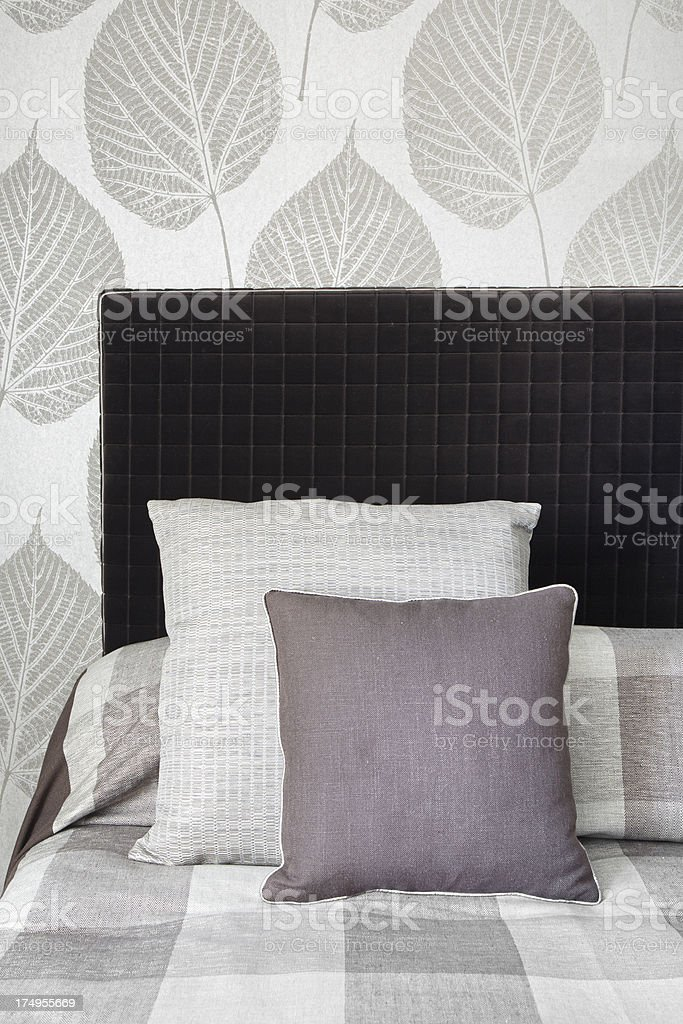 two cushions on a bed stock photo