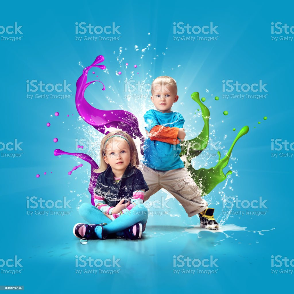 Two cute and colorful dressed kids stock photo