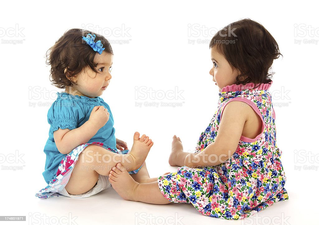 Two Cute Baby Girls Staring at Each Other royalty-free stock photo