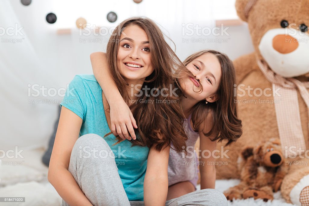 Two cute funny sisters playing and having fun stock photo