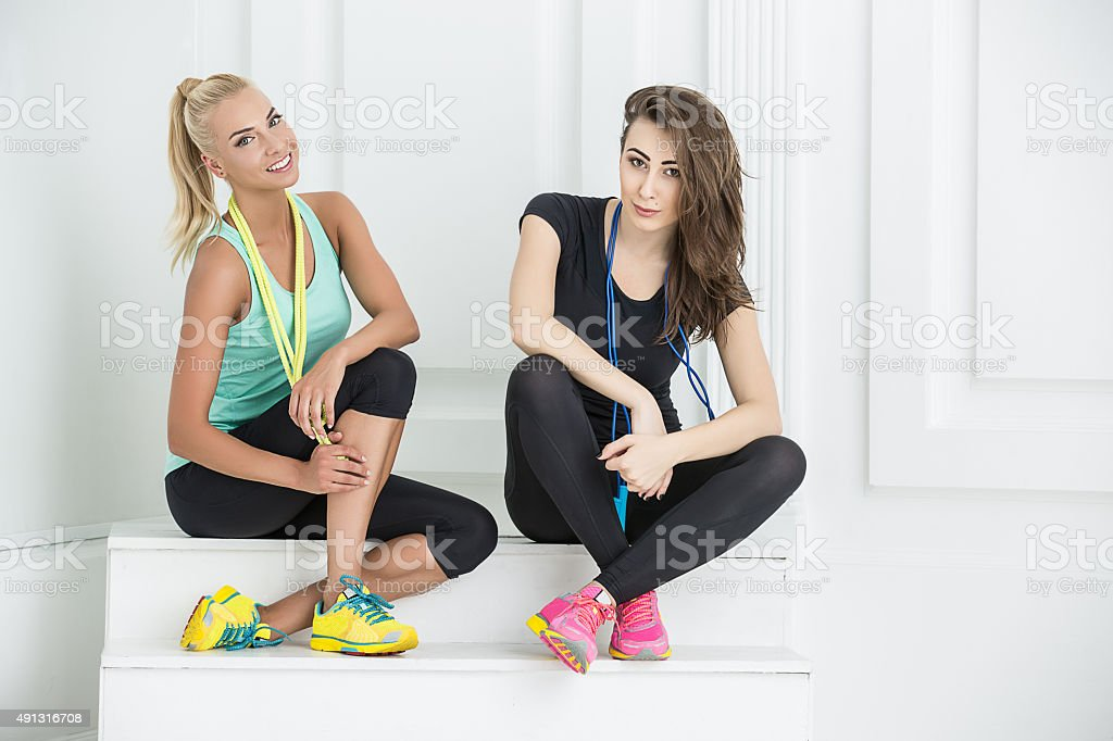 Two cute girls athletic stock photo