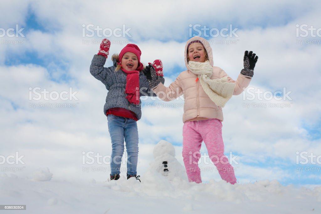 Two cute grill in the snow. stock photo
