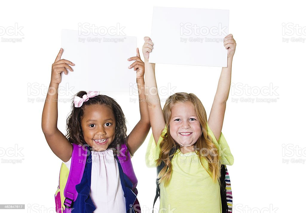 Two cute kids holding up a blank sign stock photo