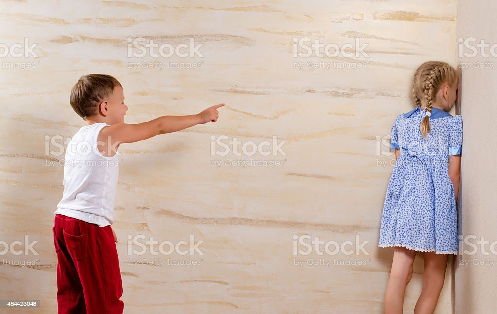 Two Cute Kids Playing Hide and Seek stock photo