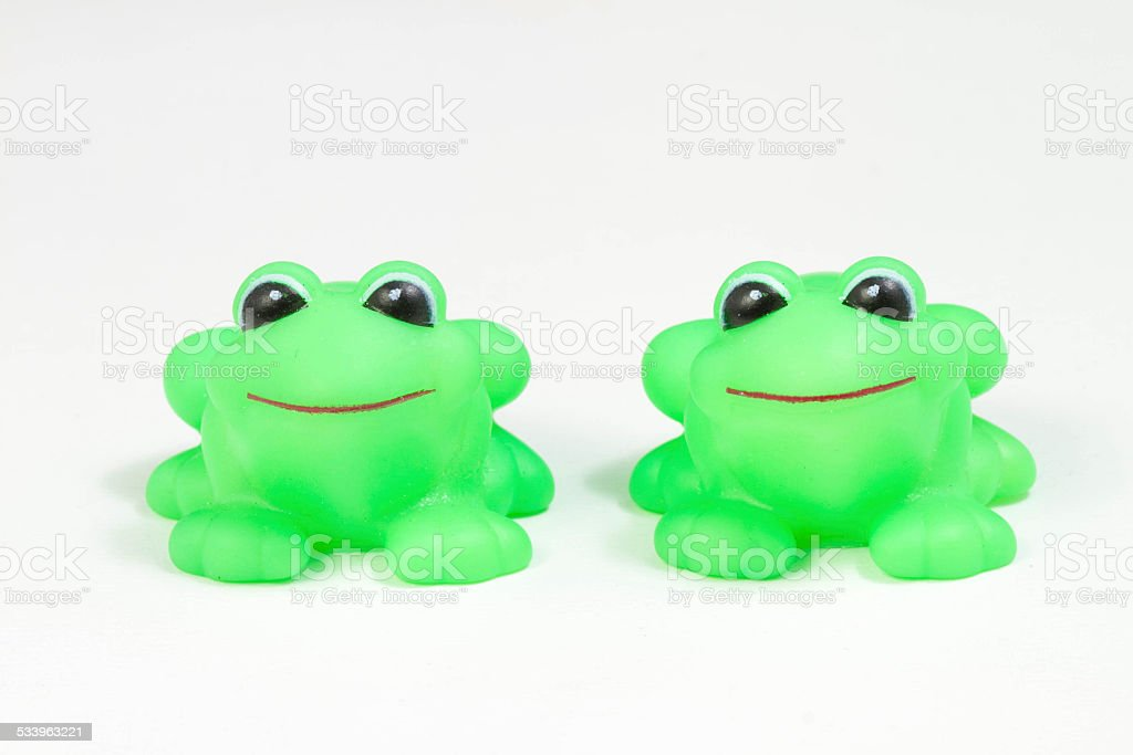 Two cute rubber frog isolated over white background royalty-free stock photo