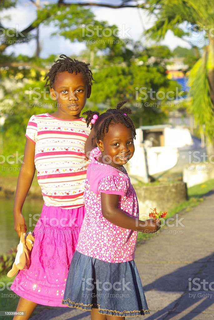 two cute sisters outdoors stock photo