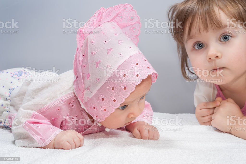 Two cute sisters stock photo