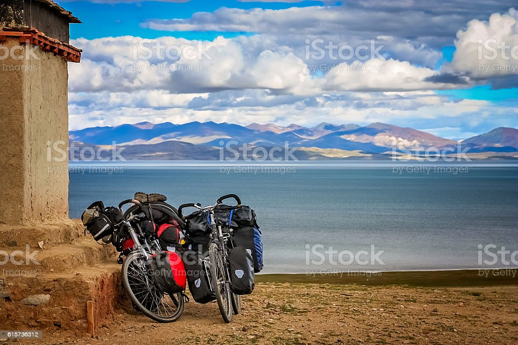 Two cycle touring bicycles on the shore of Lake Manasarovar stock photo