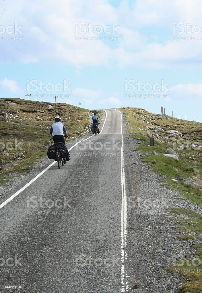 two cyclist cycling uphill stock photo