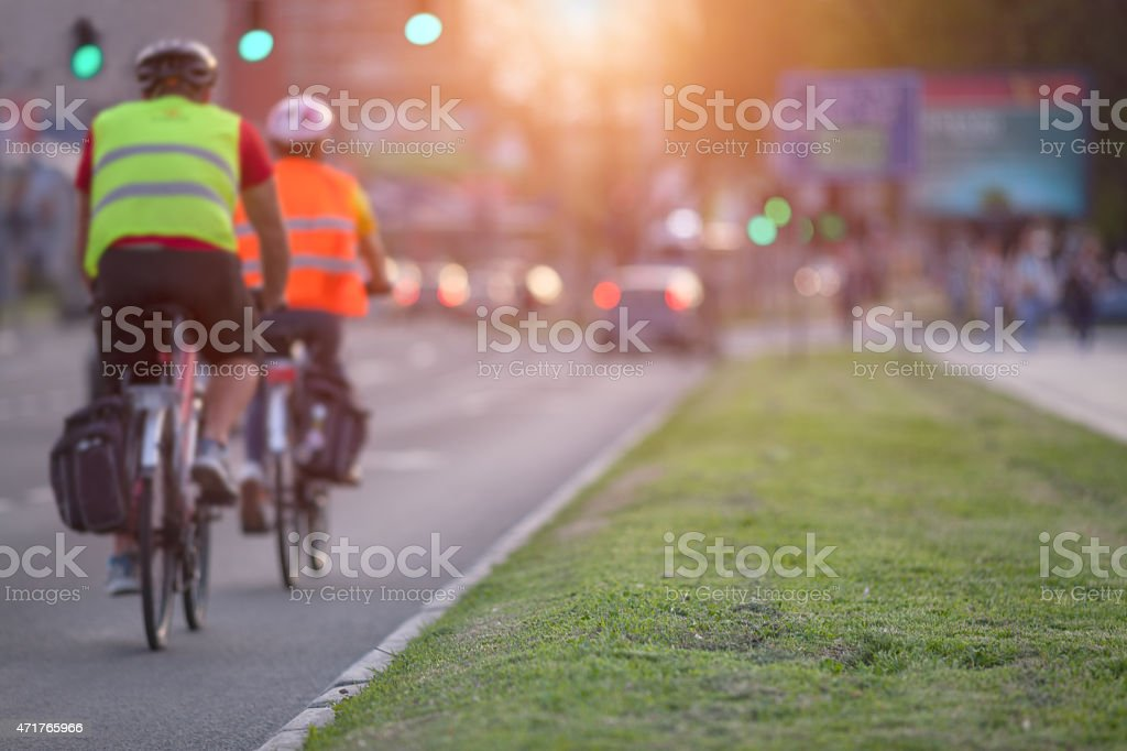 Two cyclists in a busy part of the town stock photo