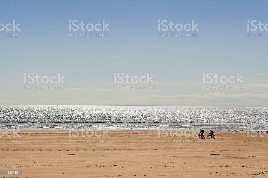 Two Cyclists On Beach royalty-free stock photo