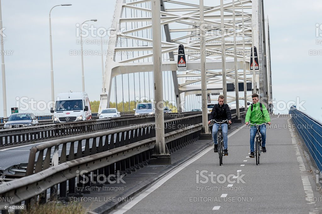 Two cyclists on the Merwedebrug Gorinchem stock photo