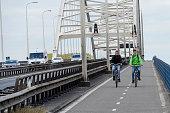 Two cyclists on the Merwedebrug Gorinchem