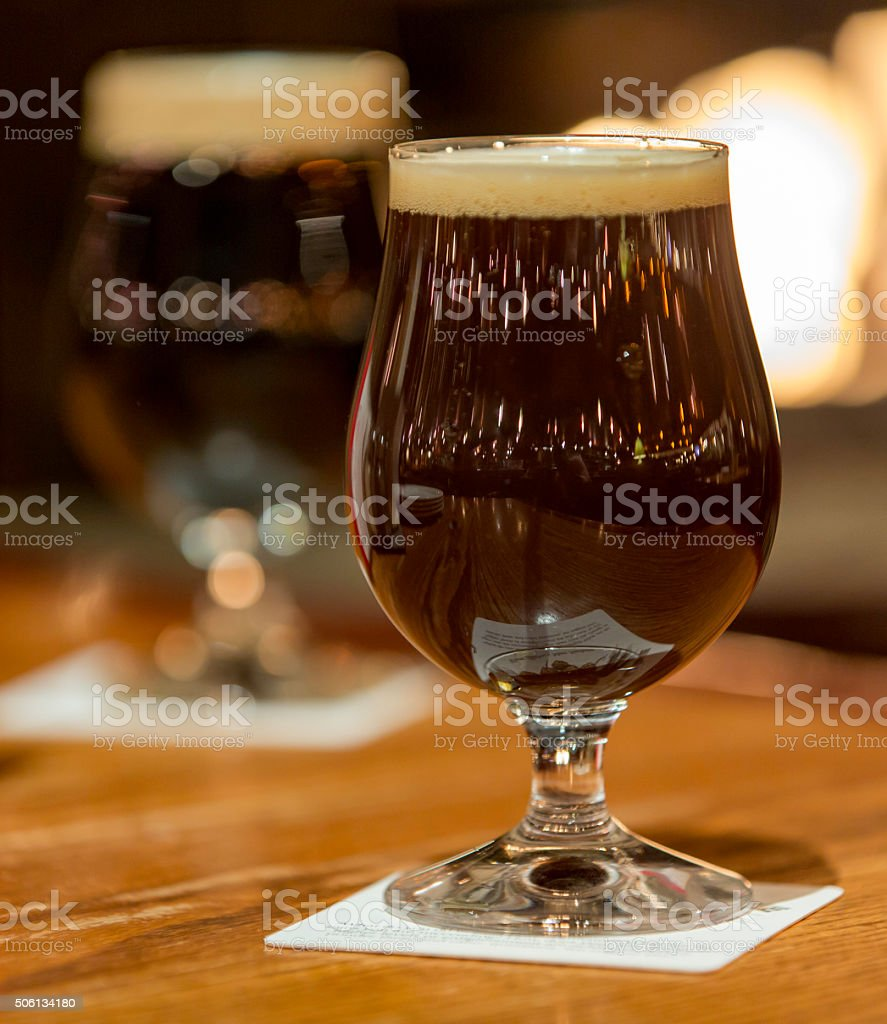 Two dark beers in a snifters stock photo