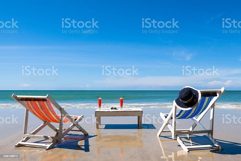 Two deckchairs on the beach for leisure during sunny day stock photo