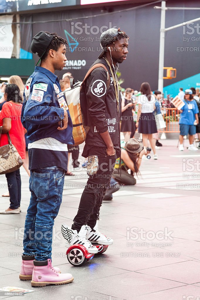 Two decked out young black men chill in Times Square. stock photo