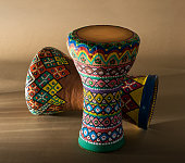 Two decorated colorful pottery goblet drums (chalice drum, tarabuka, darbuka)