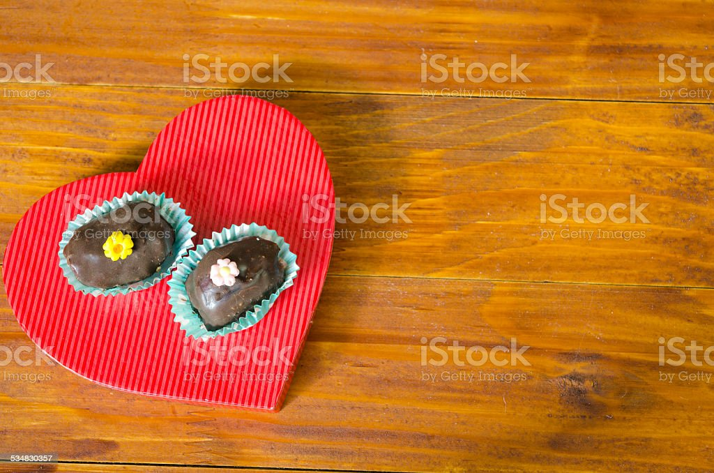 Two delicious homemade chocolate cookies on a heart royalty-free stock photo