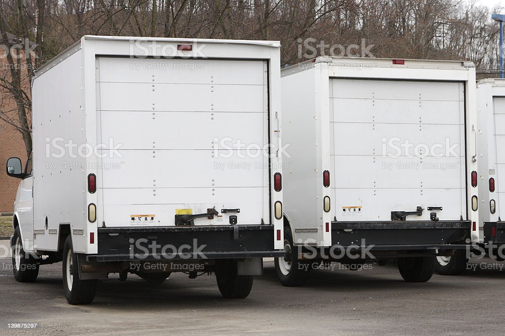 Two Delivery Trucks (Rear) stock photo