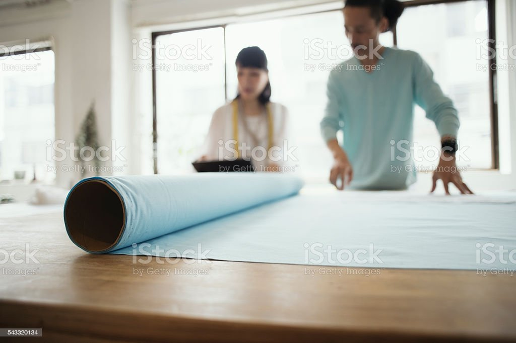 Two designers designers looking at a digital tablet stock photo