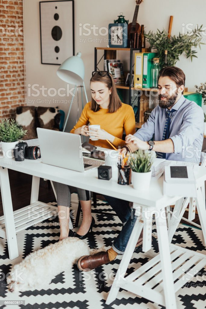 Two designers working together on a project stock photo
