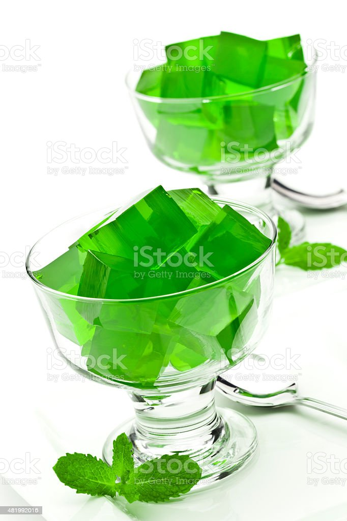 Two dessert cups filled with green gelatin cubes stock photo