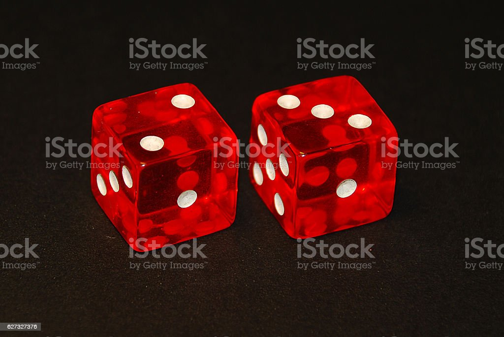 two dice on a black desk, result five (5) stock photo