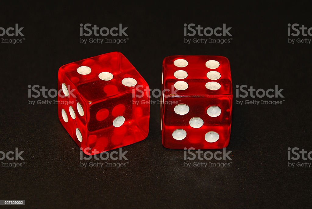 two dice on a black desk, result nine (9) stock photo