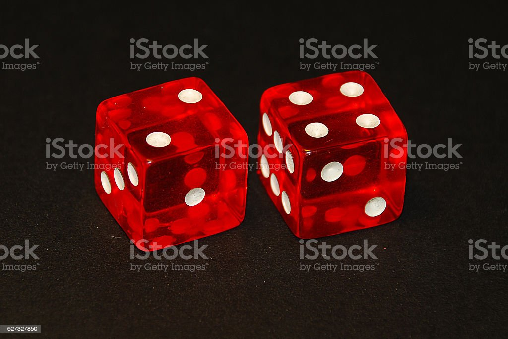 two dice on a black desk, result six (6) stock photo