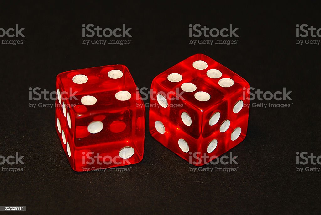 two dice on a black desk, result ten (10) stock photo