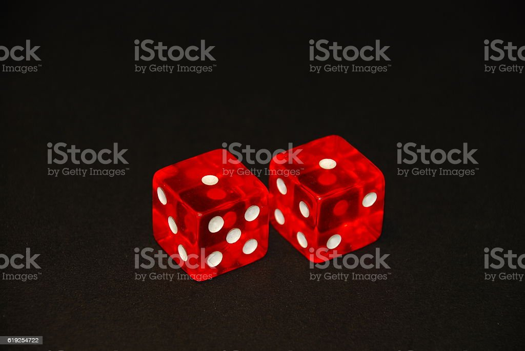 two dice on a black desk, result two (2) stock photo