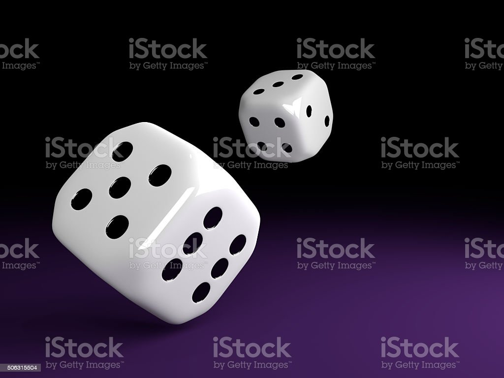 two dice rolling over violet table stock photo