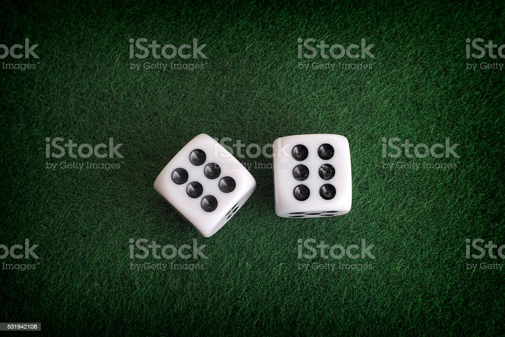 Two dices on a green background stock photo